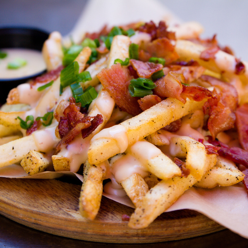 Dutchman, dirty fries with cheese, bacon and spring onions