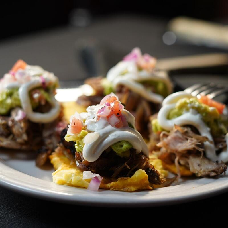 Rolled meat and vegetables with white sauce on top