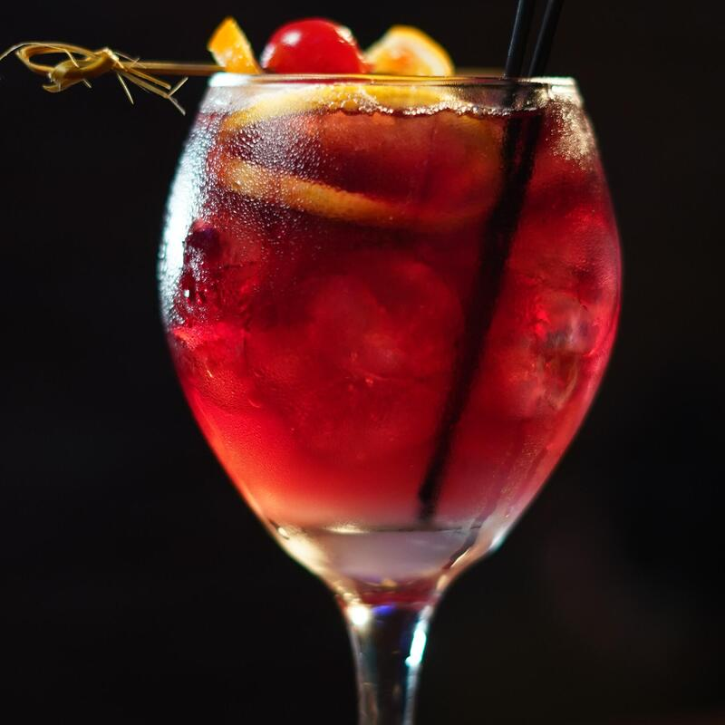 Red cocktail with fruit inside