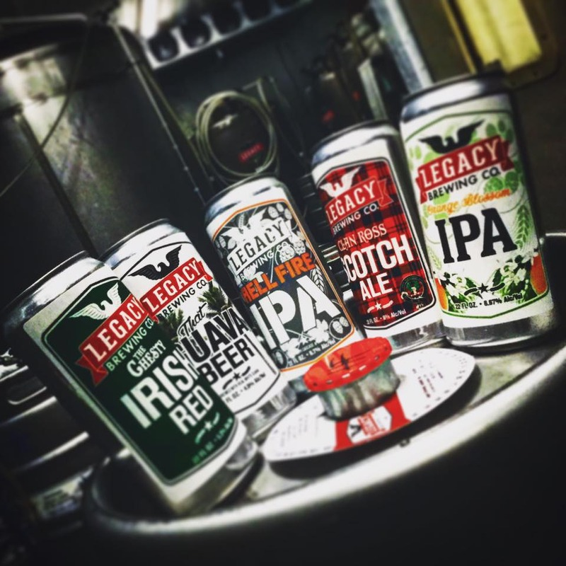Five different Legacy Brewing Co cans of beer