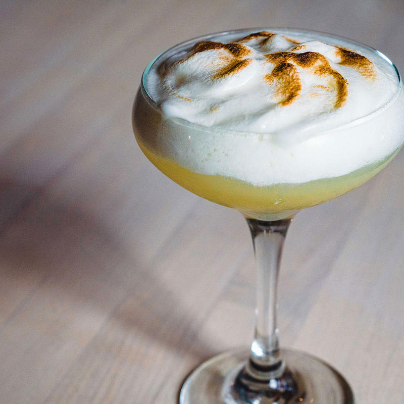 Yellow cocktail with scorched top