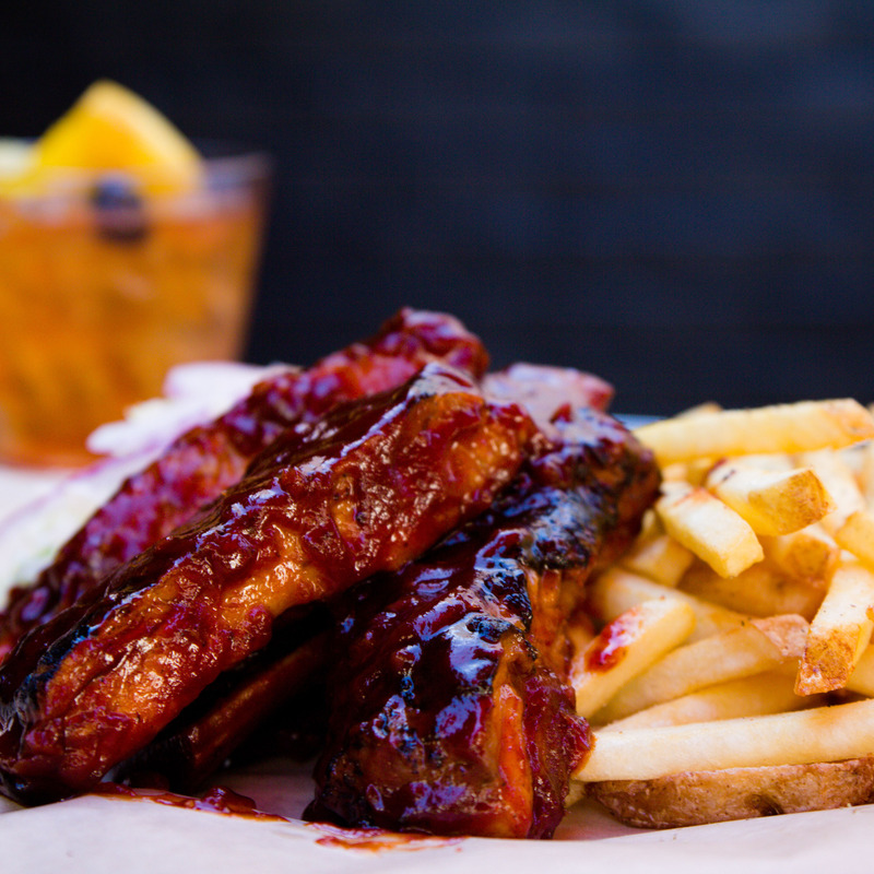Glazed ribs and fries, extreme closeup