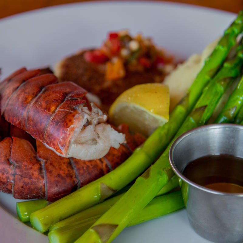 Lobster with asparagus and dip, extreme closeup