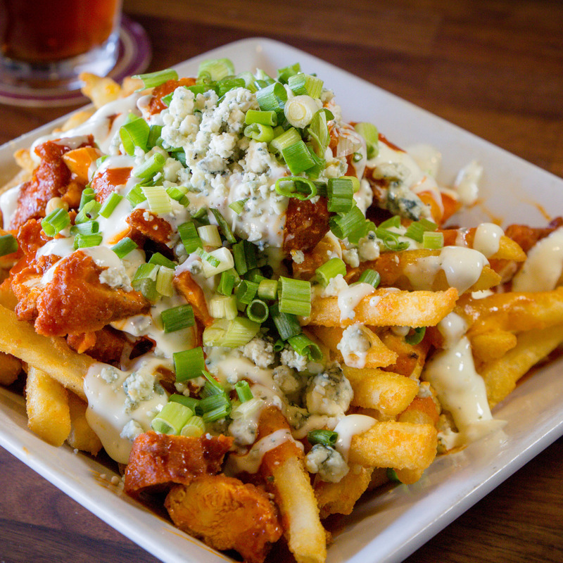 Buffalo Fries. bleu cheese crumbles, cheddar cheese,crispy chicken tenders,green onions,buffalo sauce and ranch