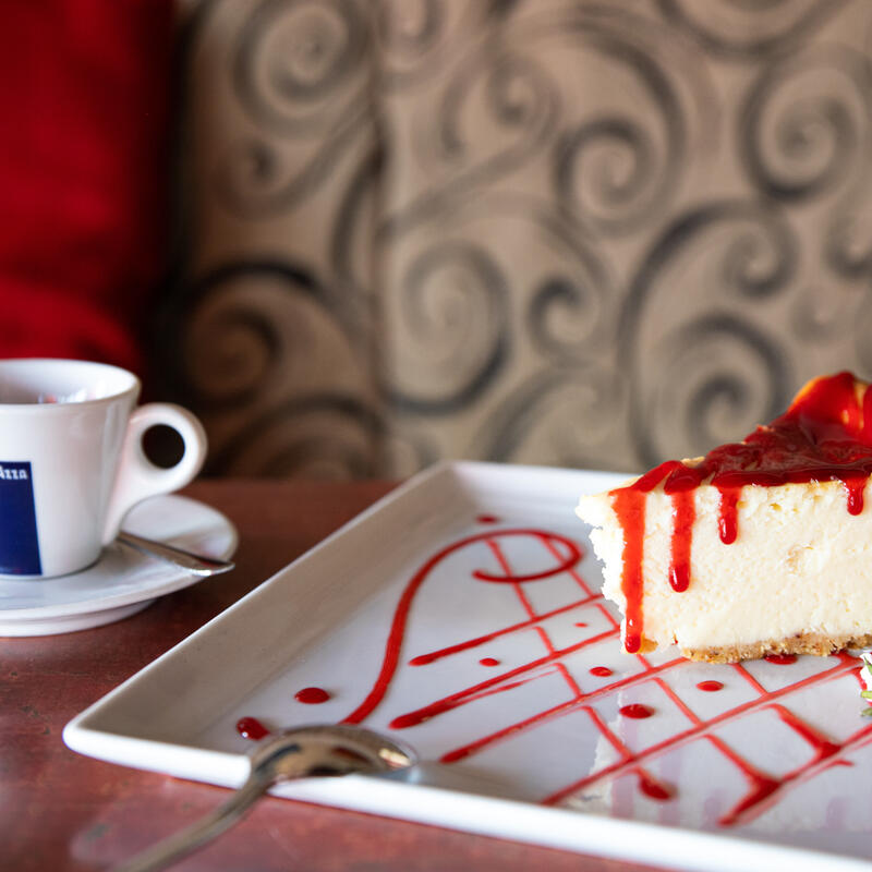 Cheese cake closeup with a cup of coffee