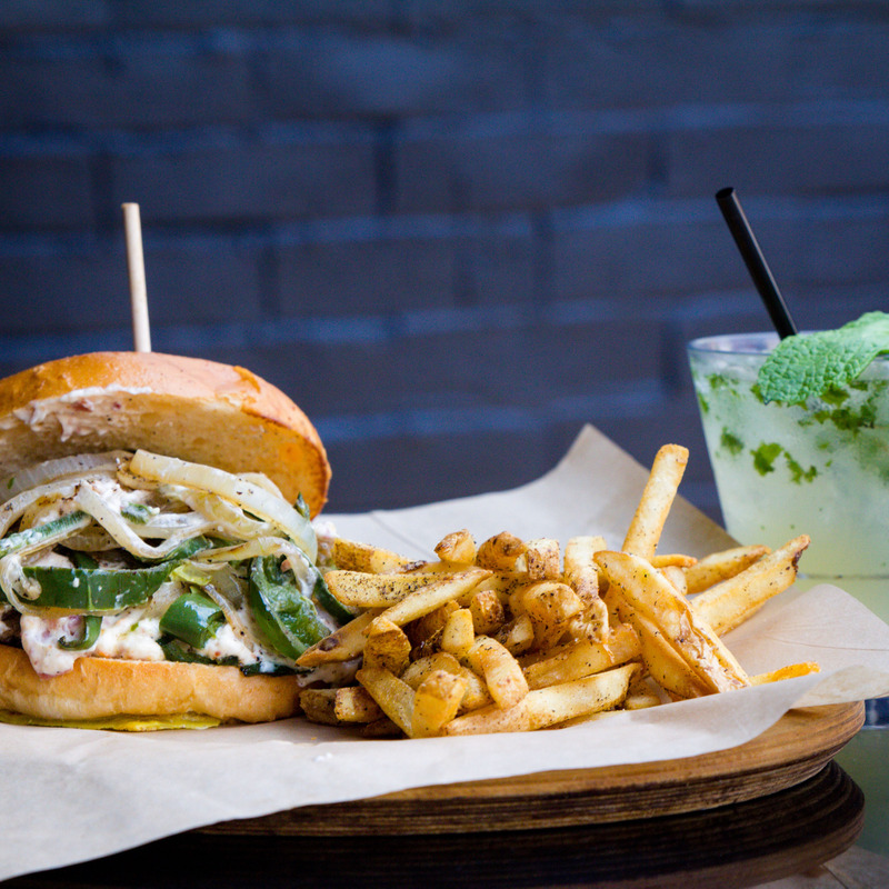 Veggie burger with fries and a mojito