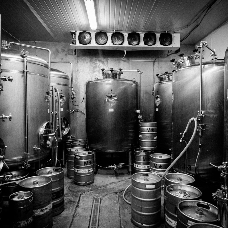 The brewing room with canisters and kegs