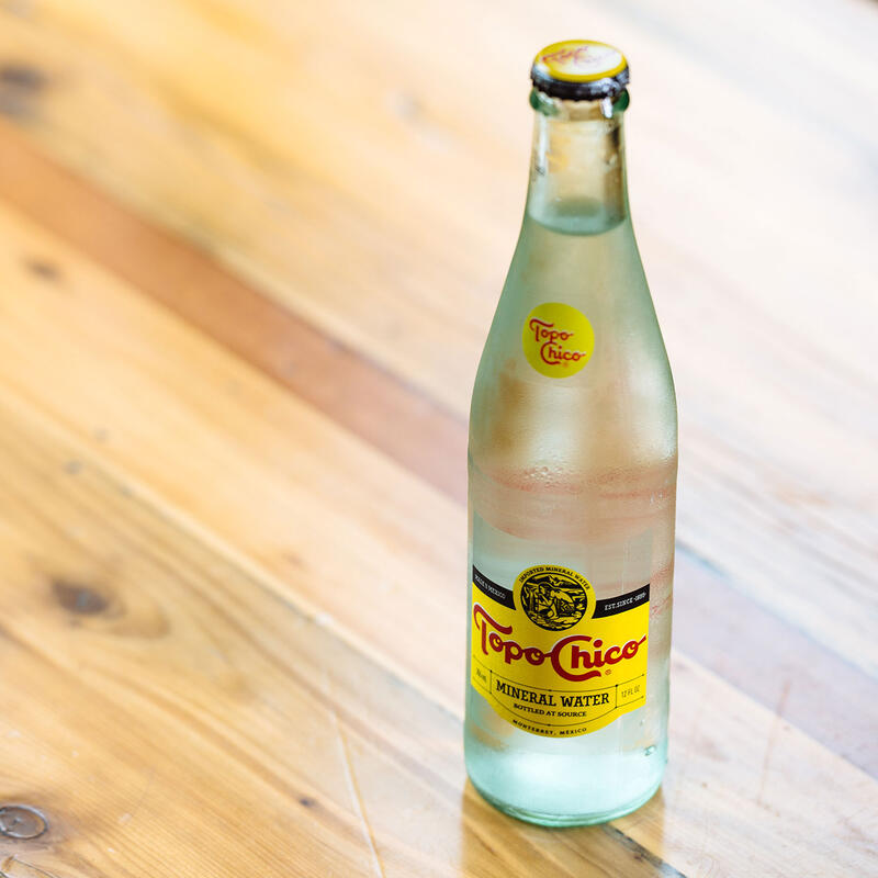 A bottle of cold refreshing mineral water
