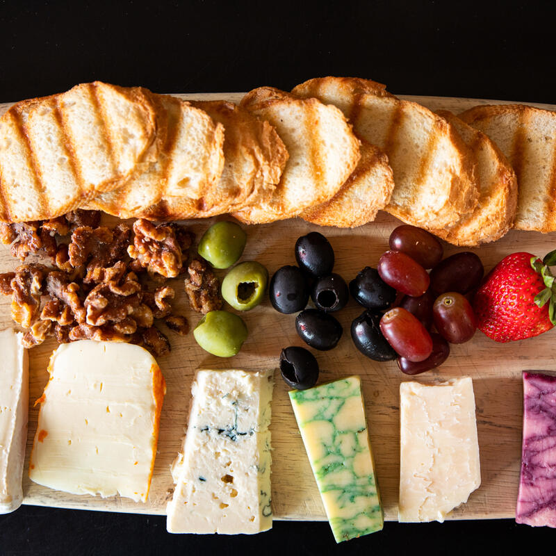 Sampler plate with cheese, fruit, olives and nuts, top view