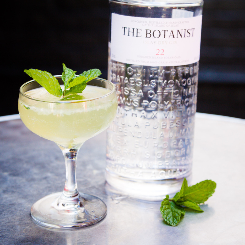 Translucent mojito and a bottle of The Botanist