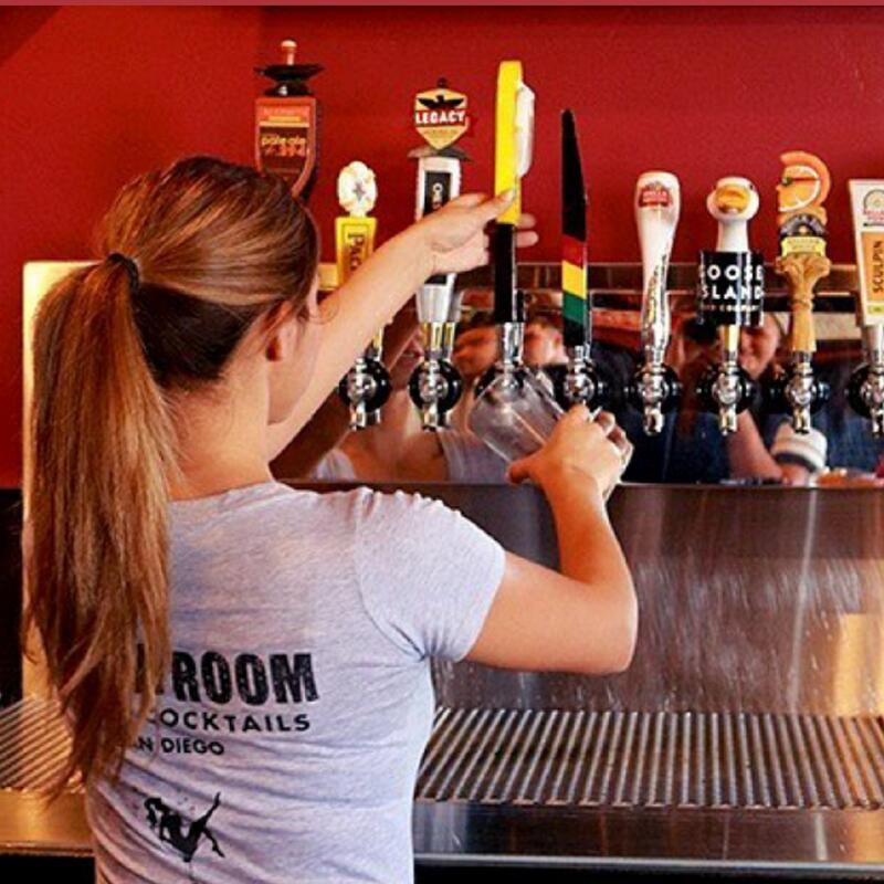Staff member pouring beer for guests