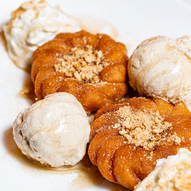 Fried pastries with ice cream and nuts