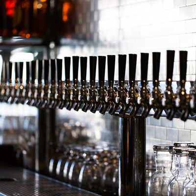A row of beer taps