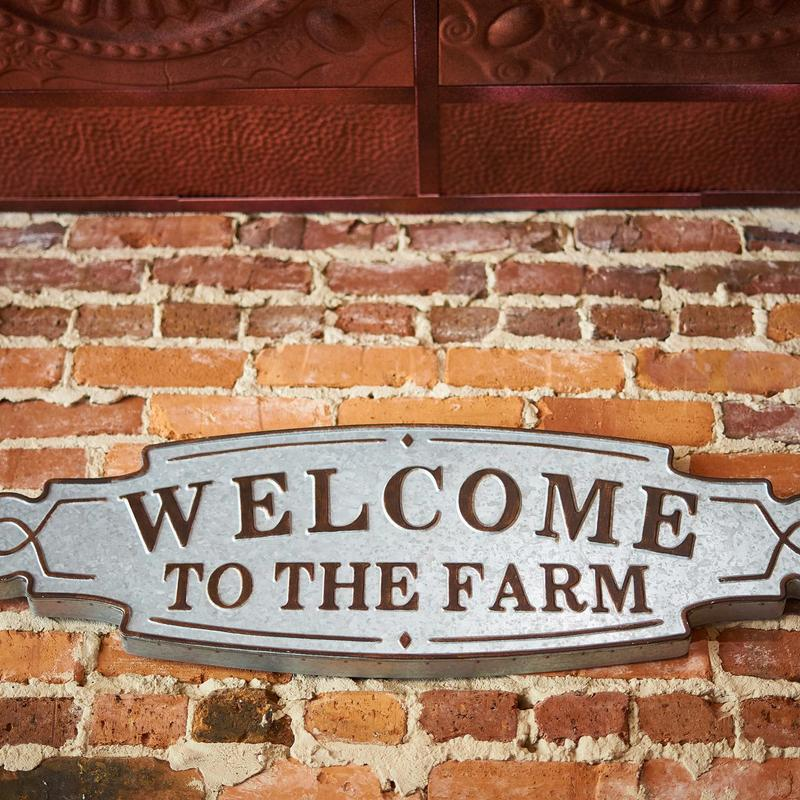 Welcome to the farm sign on the wall