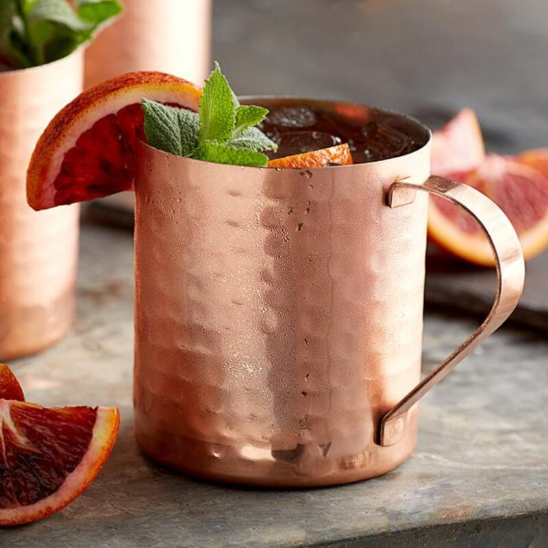 Moscow mule cocktail in a tin cup with decorations