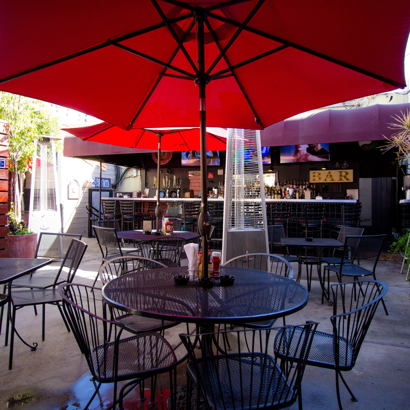 Exterior seating area with parasols and heaters