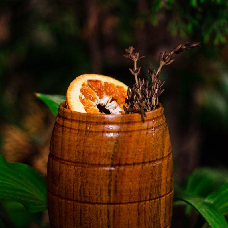 Cocktail in a wooden barrel