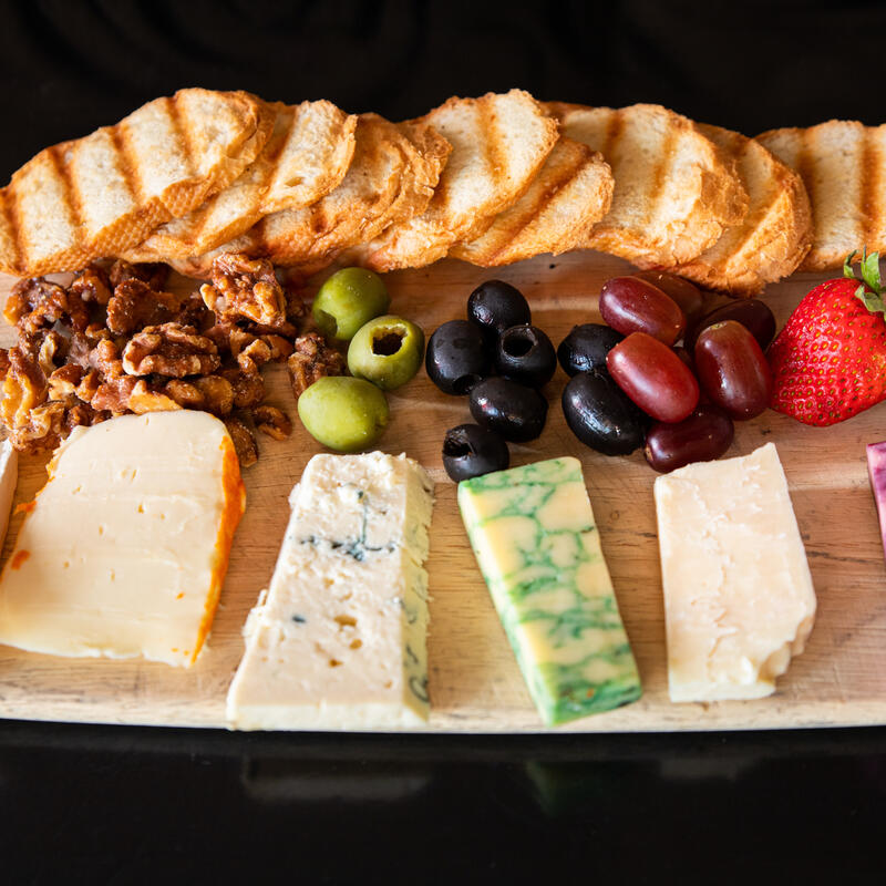 Sampler plate with cheese, fruit, olives and nuts