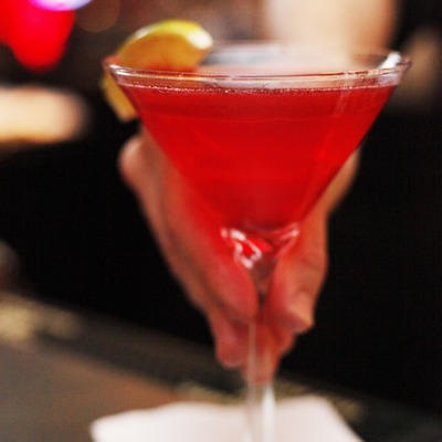 Hand holding a red cocktail, closeup
