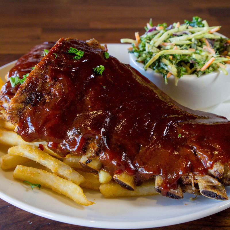 Knife & Fork Piggy Back Ribs, Slow roasted with our house bourbon BBQ sauce, Coleslaw and french fries