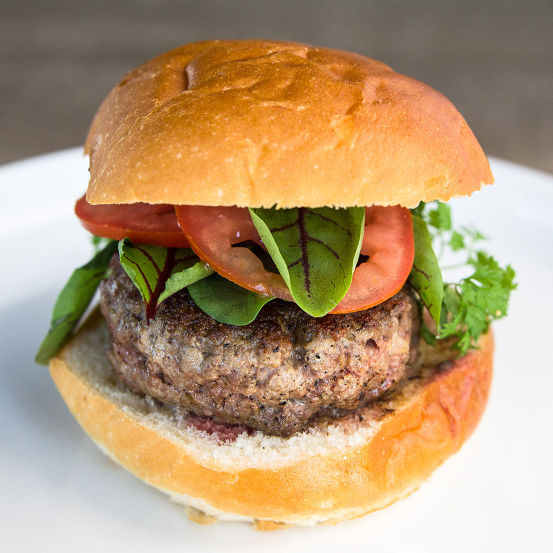 Burger with greens and tomatoes