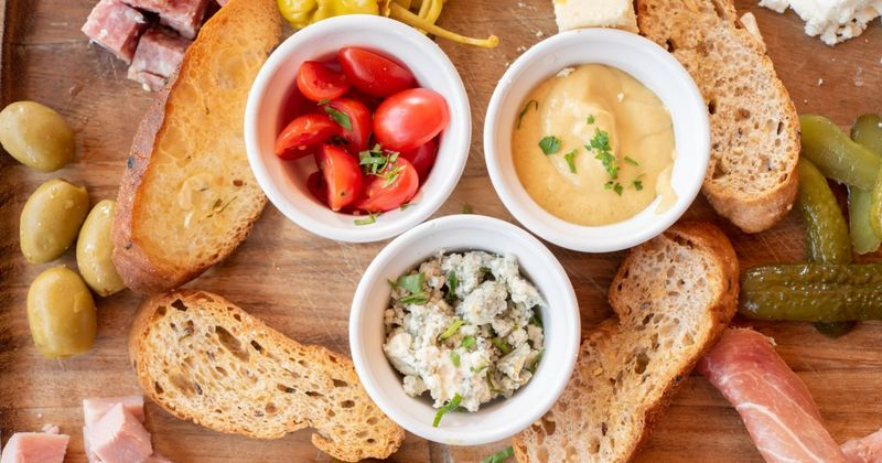 Cherry tomato, cheese, dip and snacks