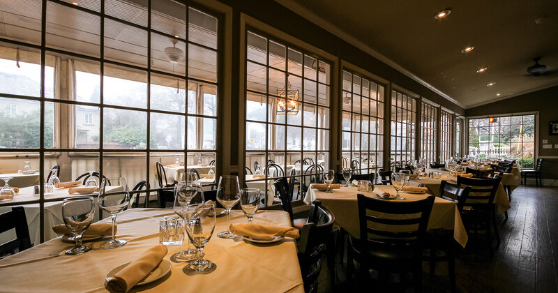 Interior, tables in a row, big windows