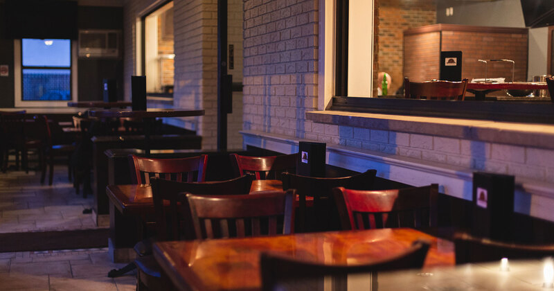Restaurant interior, tables for four lined up