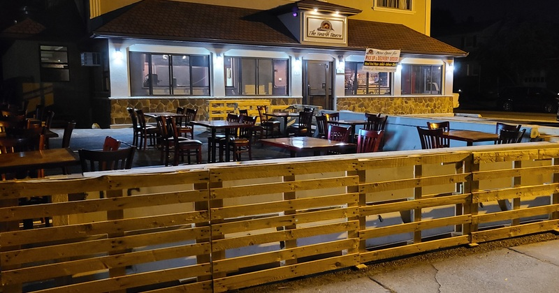 Exterior in the night, tables outside