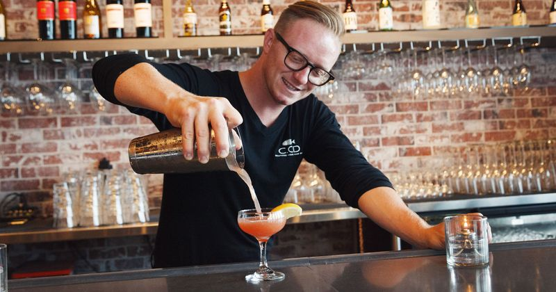 Staff member preparing cocktails
