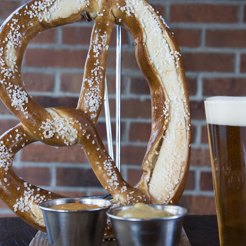 Uber pretzel  with a pint of beer in the back ground