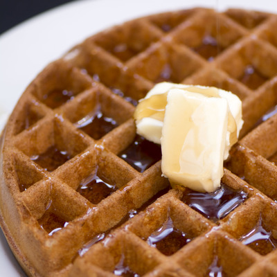 Waffles with syrup and butter closeup