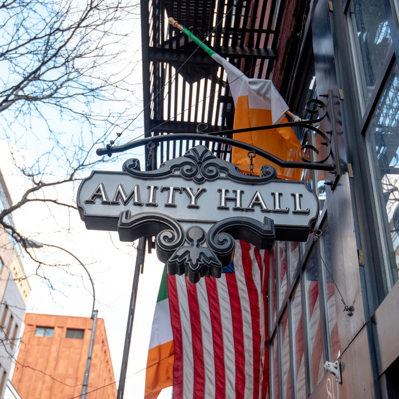 Amity HAll Sign Outside Amity Downtown
