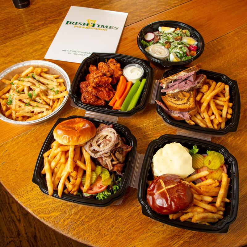 Various dishes in take out containers on the table