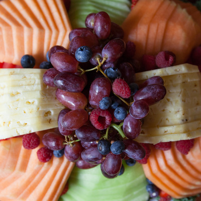 Cheese plate top view with fruit