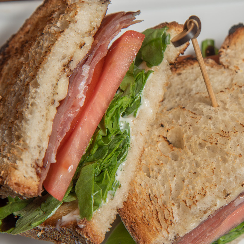 P.L.T Prosciutto, tomatoe, baby arugula, served with balsamic reduction