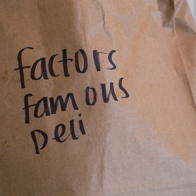 Bag with factors famous deli written on it