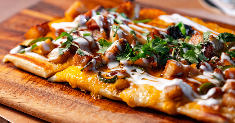 Flatbread with meat, cream and cheese