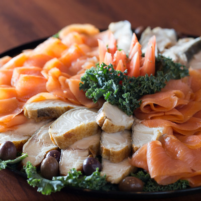 Raw fish plate with olives closeup