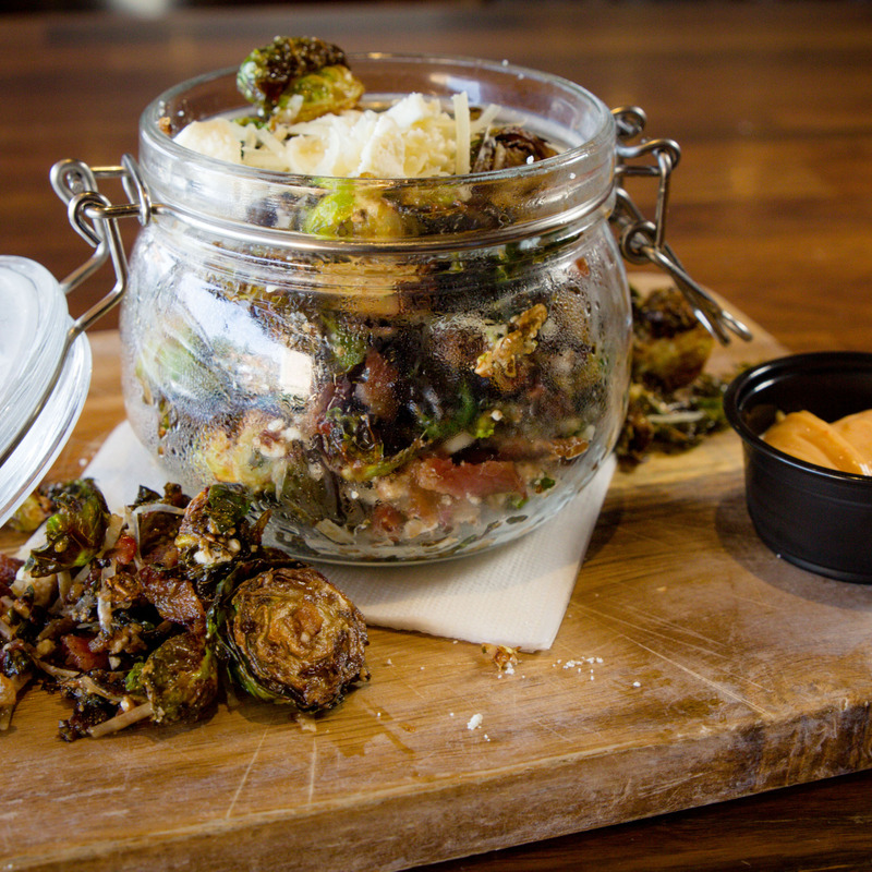 Crispy Brussel Sprouts. Bacon,Feta cheese,balsamic reduction,Parmesan cheese, cayenne aioli