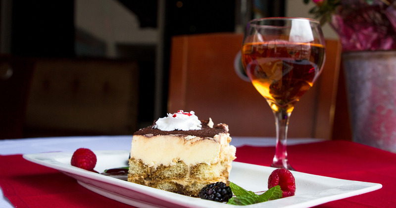 tiramisu and glass of wine