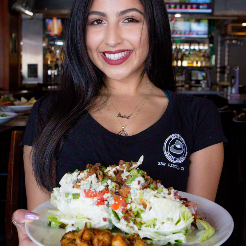 Server Isabel featuring the Wedge Salad with Blackened Shrimp