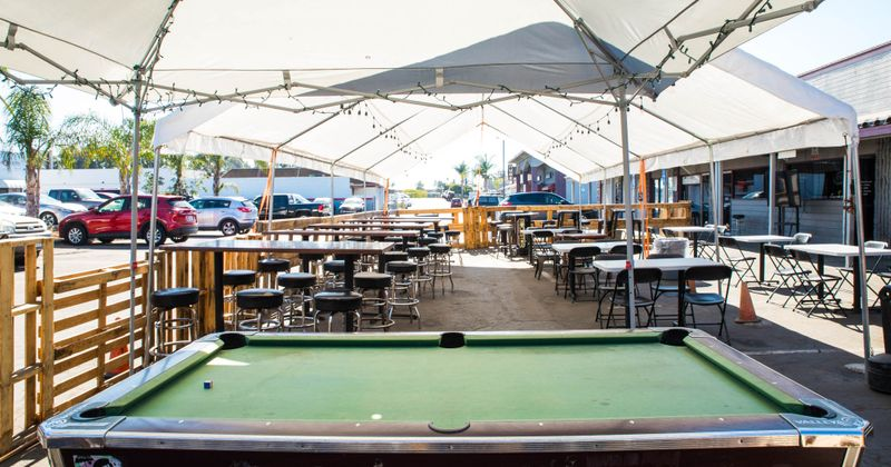 Restaurant outdoor, pool table, chairs and tables