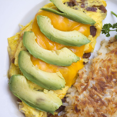 Omlette with avocado and fried rice