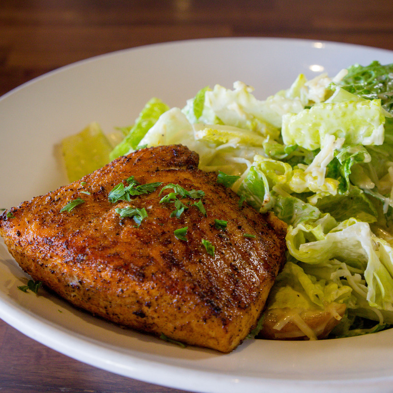 Caesar salad: Romaine Hearts, Parmesan Cheese, croutons, house made caesar dressing. Choice of Protein: Blackened Salmon