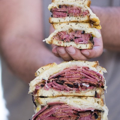 Pastrami sandwiches in hands
