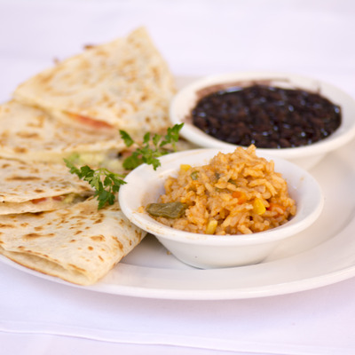 Tortilla with rice and black beans on the side