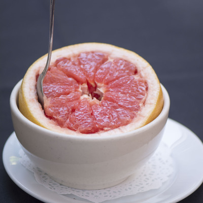 Grapefruit half with a spoon