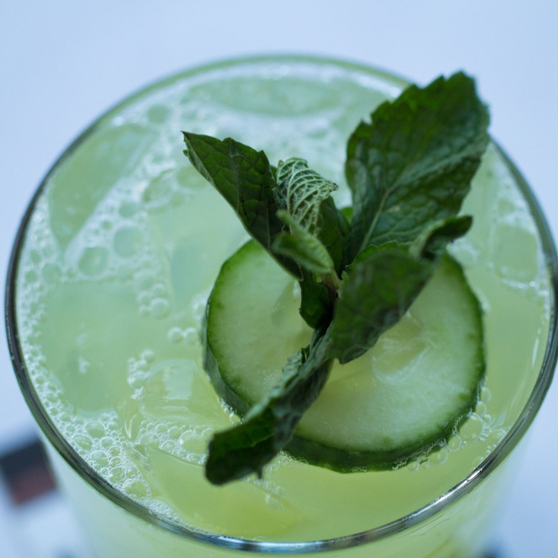 a view of a drink with cucumber from above