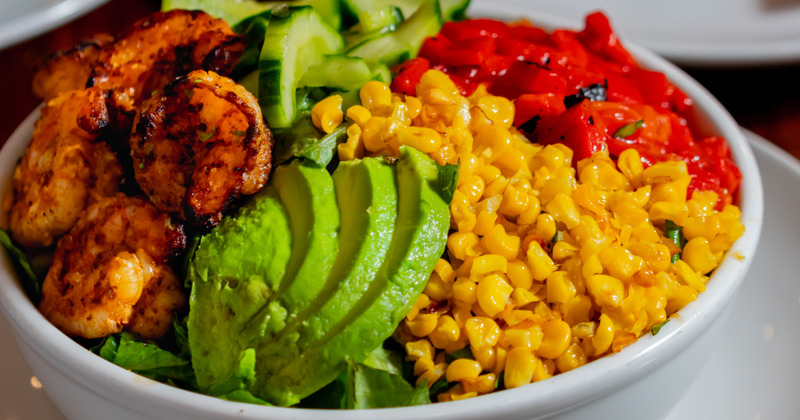 Cucumber, corn, pepper, avocado and shrimp dish